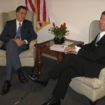 Presidential candidate Mitt Romney sits with Ray Collins in Sarasota.